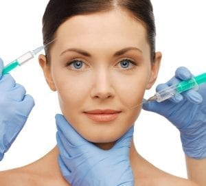 woman getting dermal fillers injection
